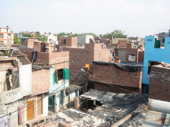 Exposed walls show the bleak structural safety of houses in Sunder Nagari Delhi